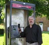 Cllr Charles Royden with Carron Road Payphone