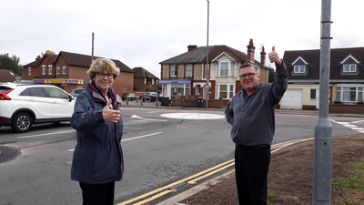 Councillors Christine McHugh and Tim Caswell at the roundabout at the junction of Goldington Green and Goldington Road