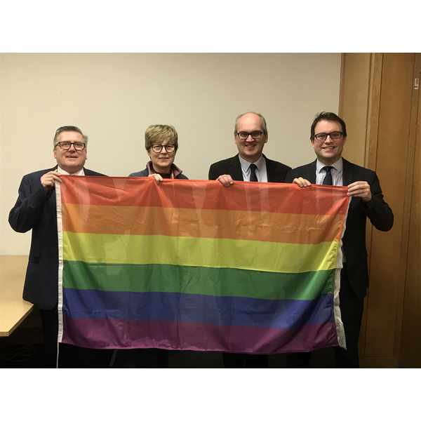 Cllrs Tim Caswell, Christine McHugh, Michael Headley and Henry Vann with the Rainbow Flag